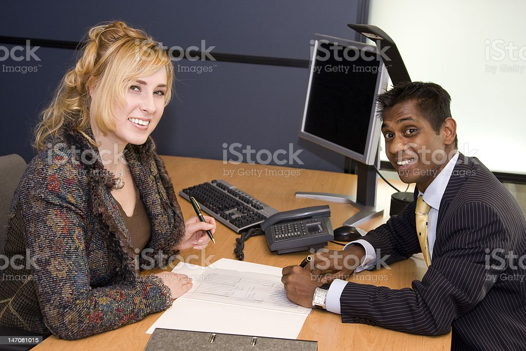 Young Professionals Signing a Contract royalty-free stock photo