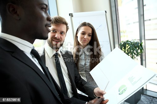 istock Young professionals work in modern office.Business crew working with startup. 618329816