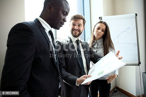 istock Young professionals work in modern office.Business crew working with startup. 618329900