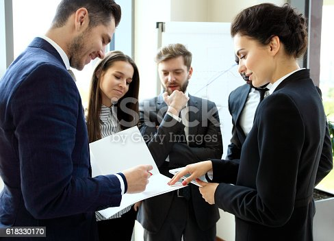 istock Young professionals work in modern office.Business crew working with startup. 618330170