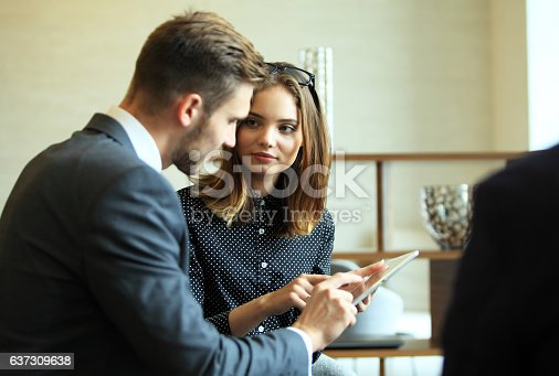 istock Young professionals work in modern office.Business crew working with startup. 637309638