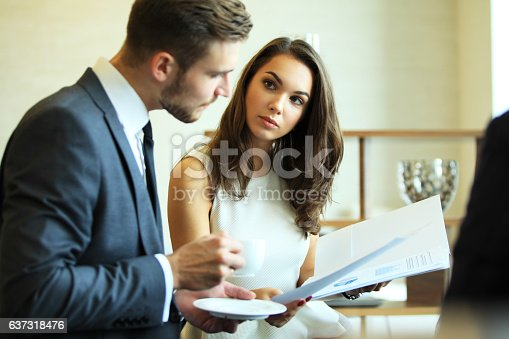 istock Young professionals work in modern office.Business crew working with startup. 637318476