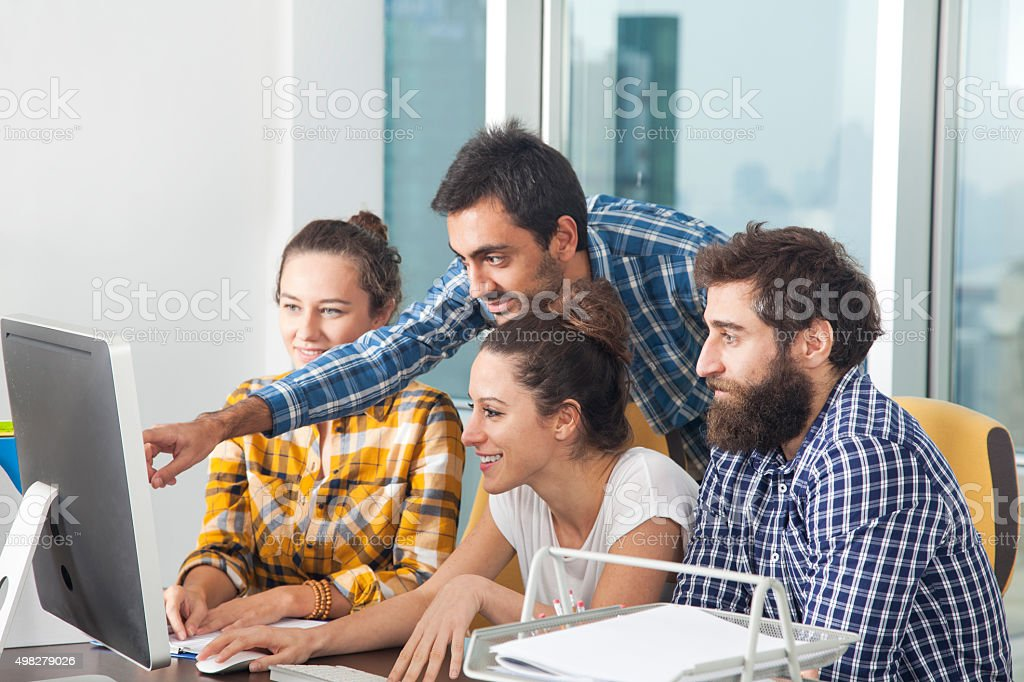 Young proffessional team working together in the office stock photo
