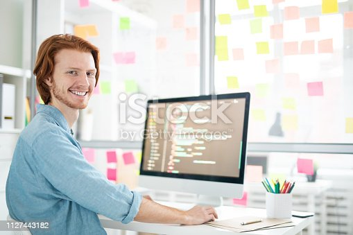 1098316816 istock photo Young programmer 1127443182