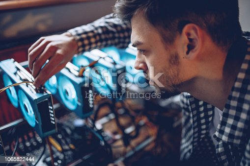 Programmer preparing mining rig for cryptocurrency mining