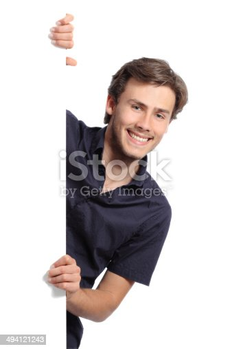 istock Young promoter man holding a blank banner 494121243