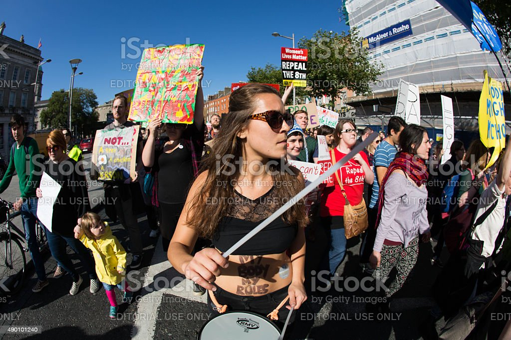 Young protester with tattooed belly my body my rules stock photo