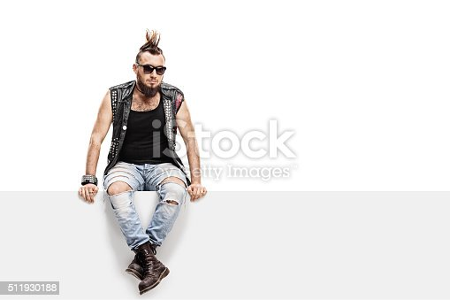 istock Young punk rocker with a Mohawk hairstyle 511930188