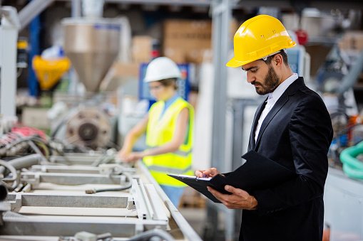 Young Quality Inspector Checking Production Line Stock Photo - Download Image Now