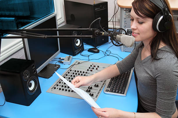 young radio news woman in the studio - radio dj stock photos and pictures