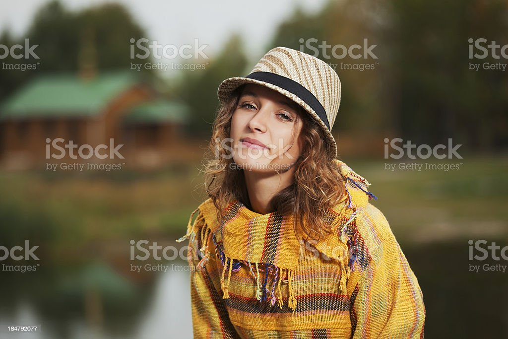 Young rastafarian woman in autumn park royalty-free stock photo