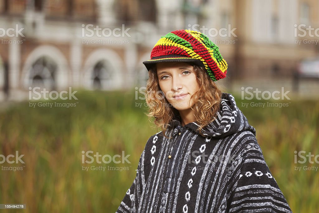 Young rastafarian woman on a city street stock photo