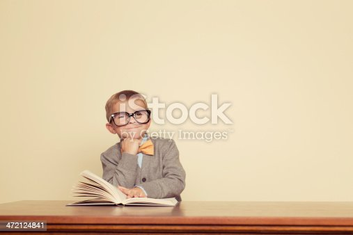 A young boy loves to read.