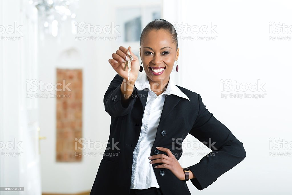 Young realtor with keys in an apartment stock photo