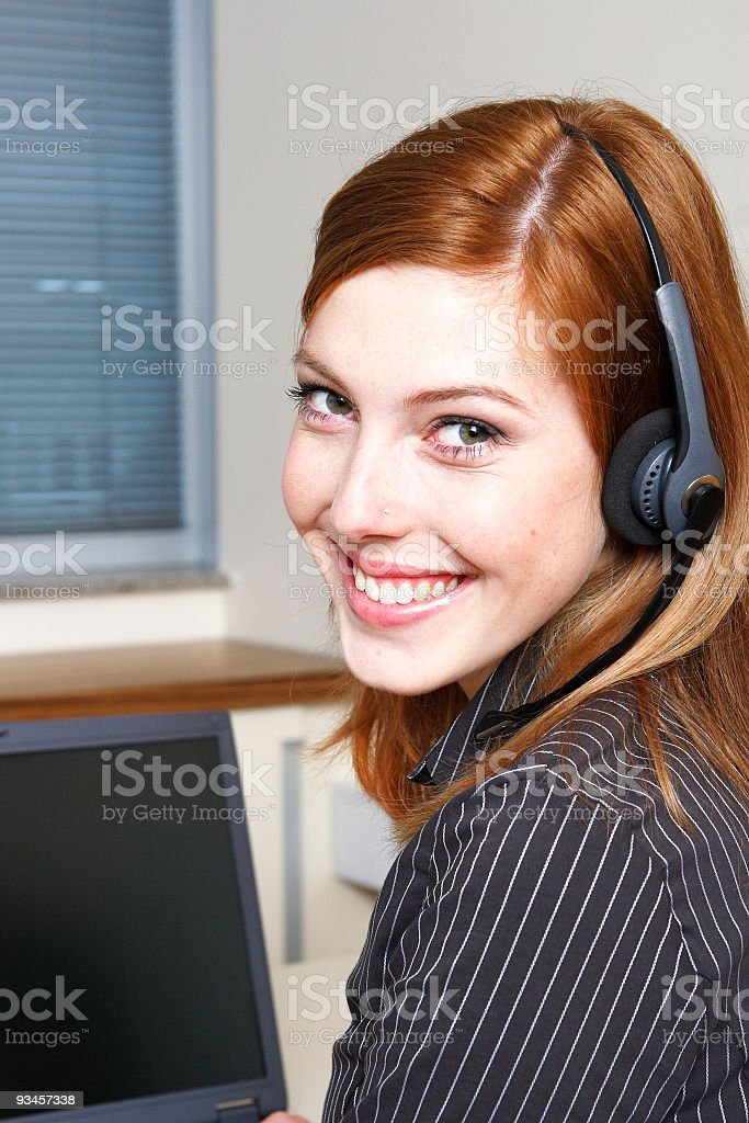 Young red hair girl with headset stock photo