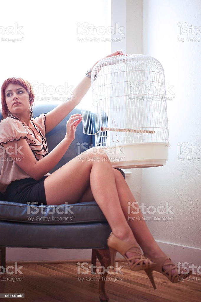 Young Red Haired Woman Reclining in a Blue Chair royalty-free stock photo