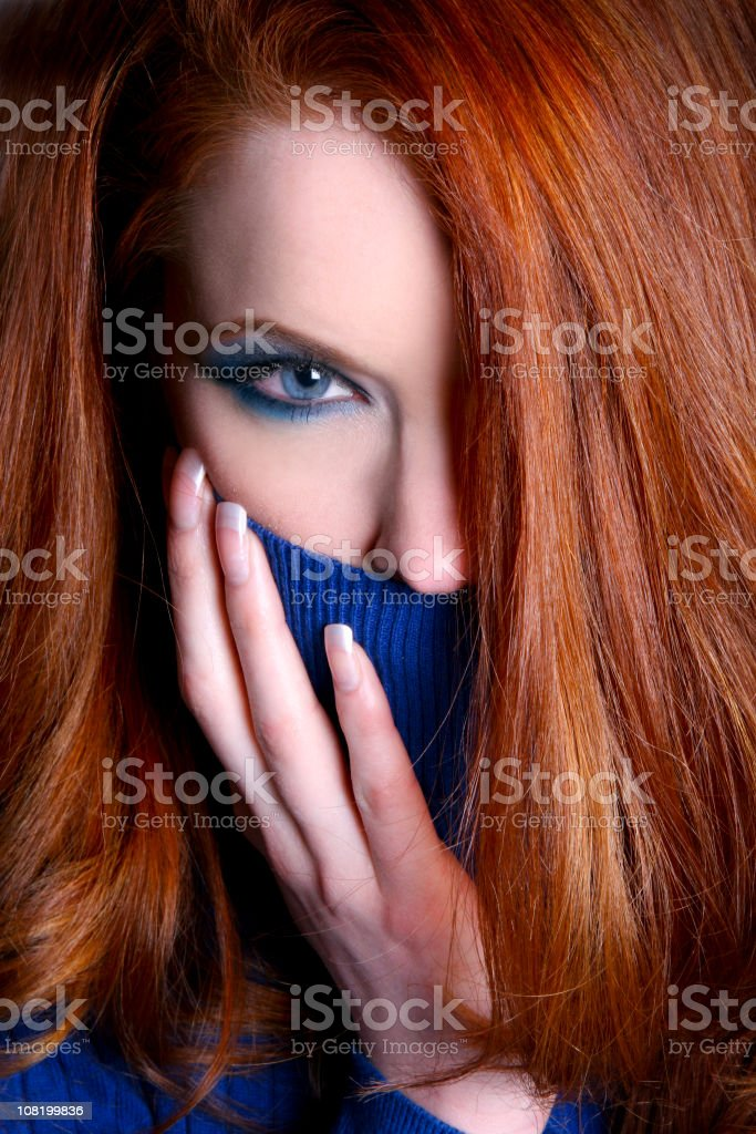 Young Red Haired Woman Wearing Blue Turtle Neck Sweater stock photo
