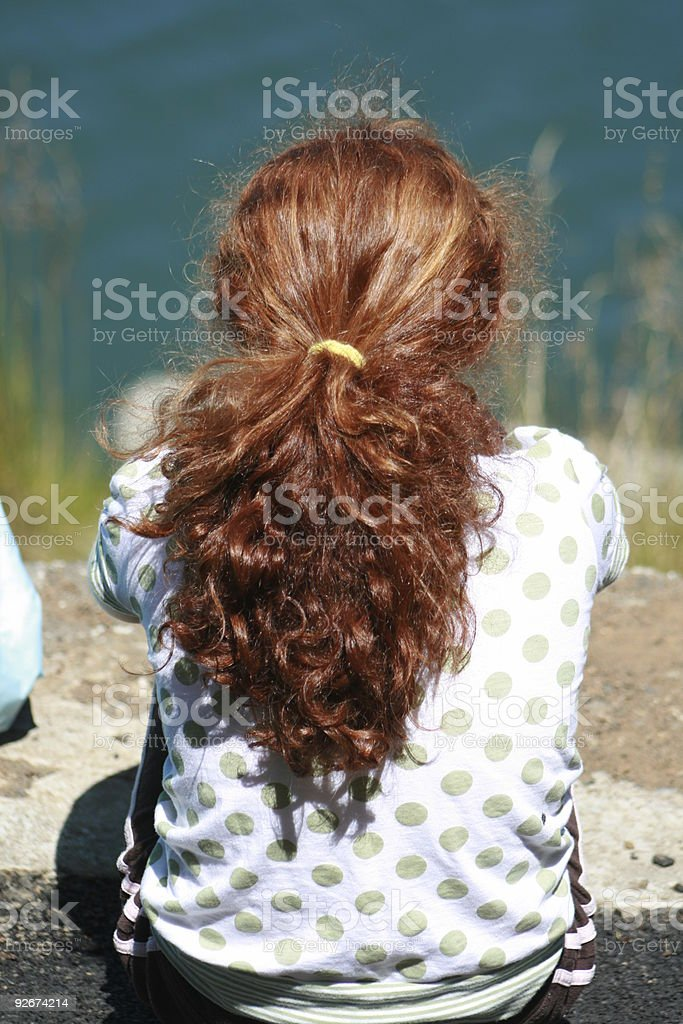 Young Red Headed Girls Sits Alone royalty-free stock photo
