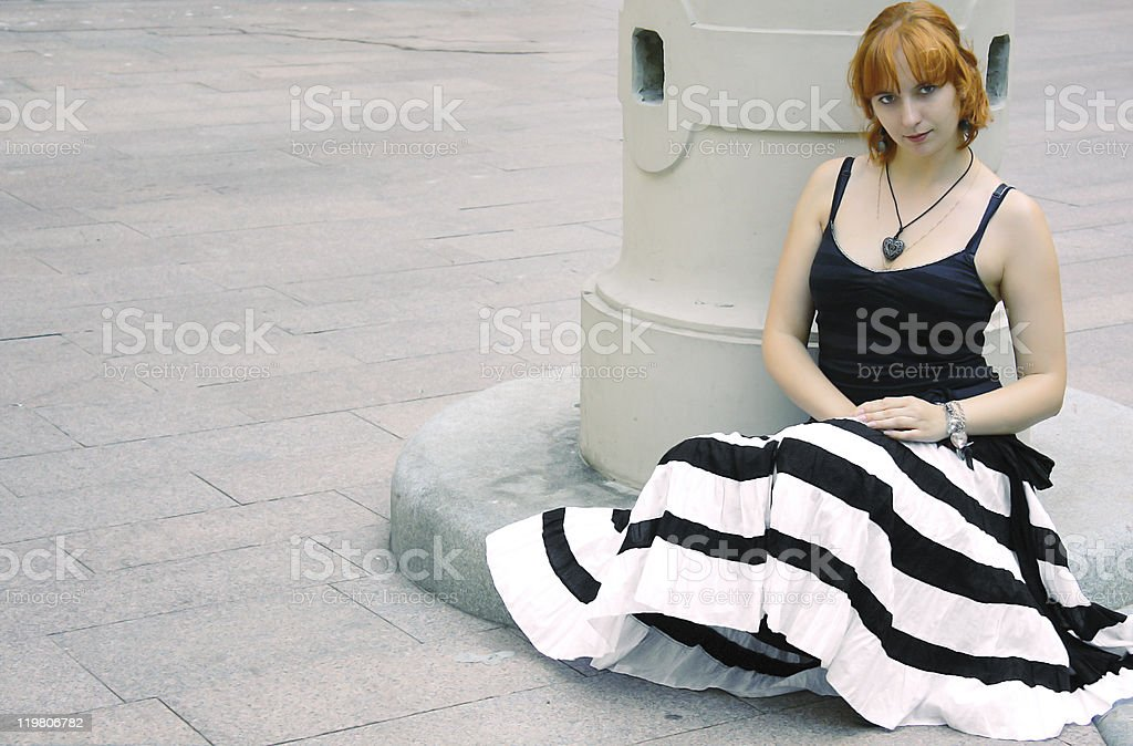 e1d0dc3839 Young red woman in flared striped black and white skirt - Stock image .