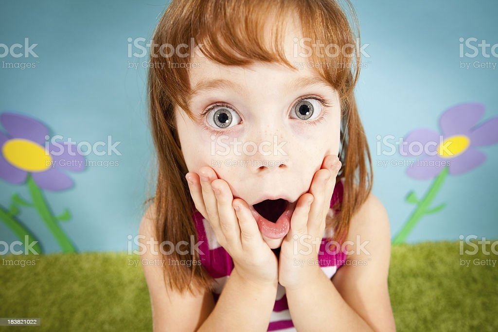 Young Red-Haired Girl Gasping with Surprise in Whimsical World royalty-free stock photo
