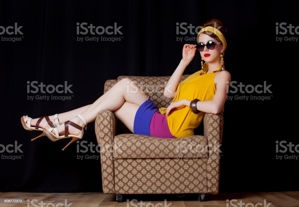 Young redhead girl in 70s clothes style stock photo