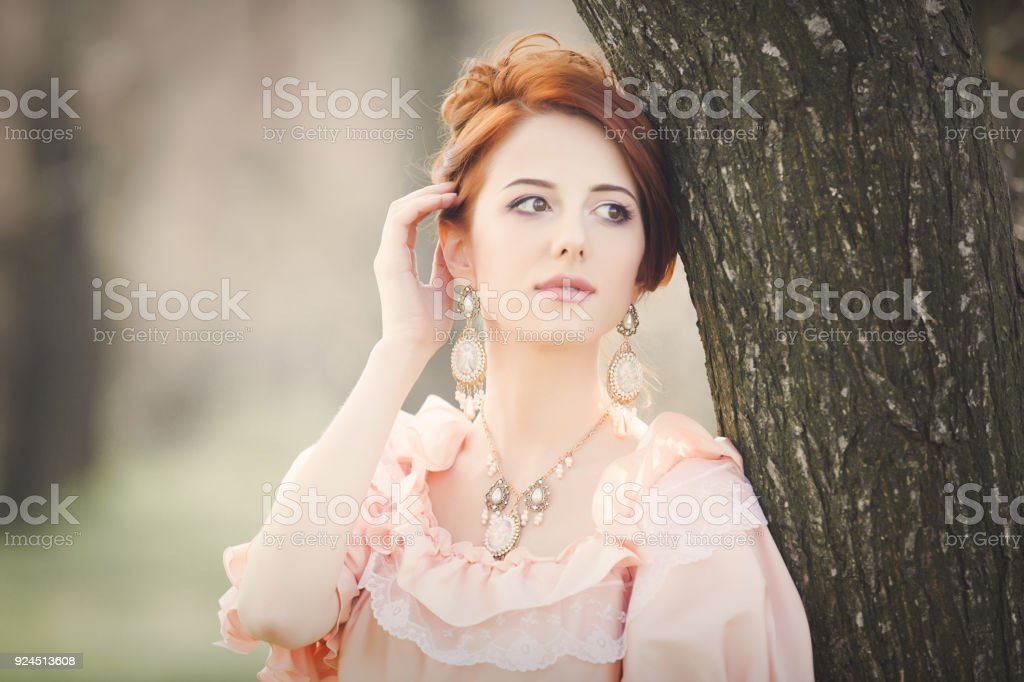 Young redhead girl in Victorian era clothes stock photo