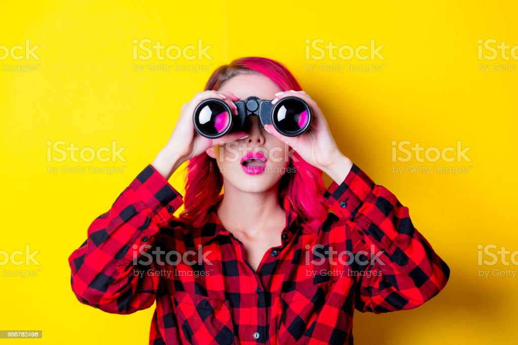 Young redhead girl with binoculars stock photo