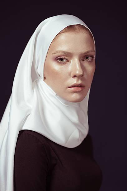 young religious woman in a white shawl - hermana fotografías e imágenes de stock