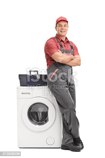 istock Young repairman leaning on a washing machine 510308038