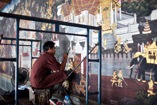 Young restorer working in Grand Palace in Bangkok, Thailand stock photo