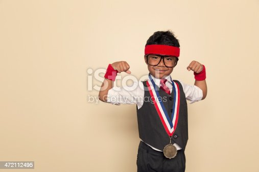 istock Young Retro Business Boy Flexes Muscles and Gold Medal 472112495