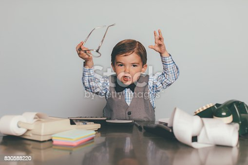 istock Young Retro Business Boy is Displeased at Work 830588220