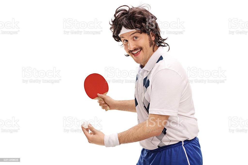 Young retro man playing table tennis stock photo