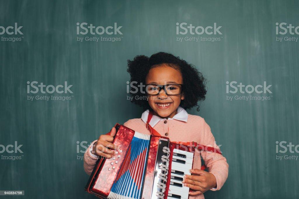 Young Retro Nerd Girl Playing Accordion stock photo
