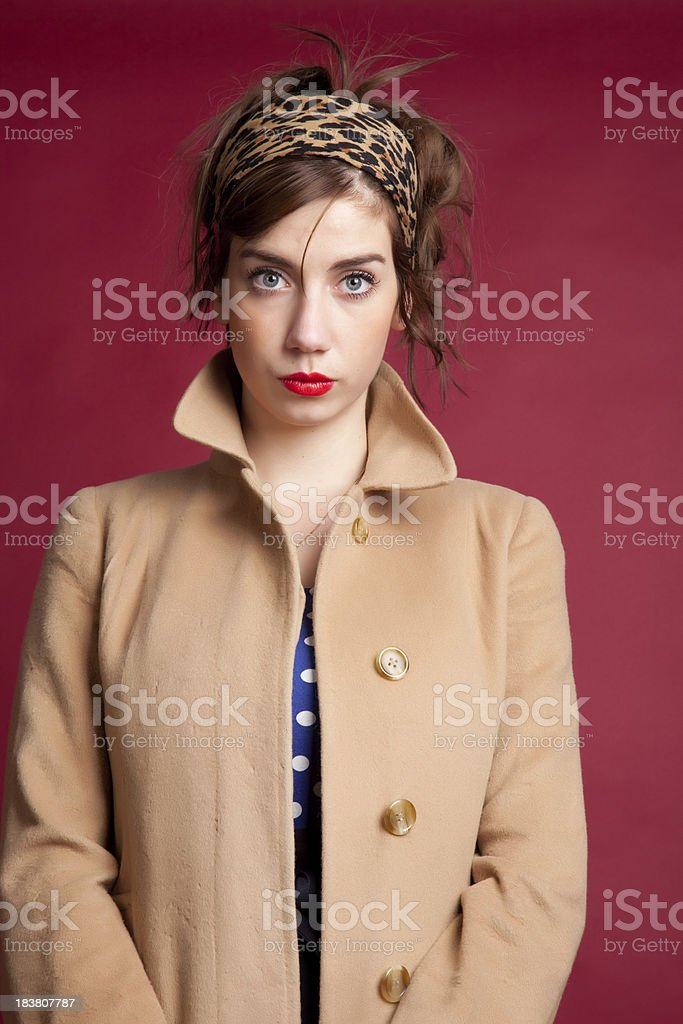 Young retro woman in coat stock photo