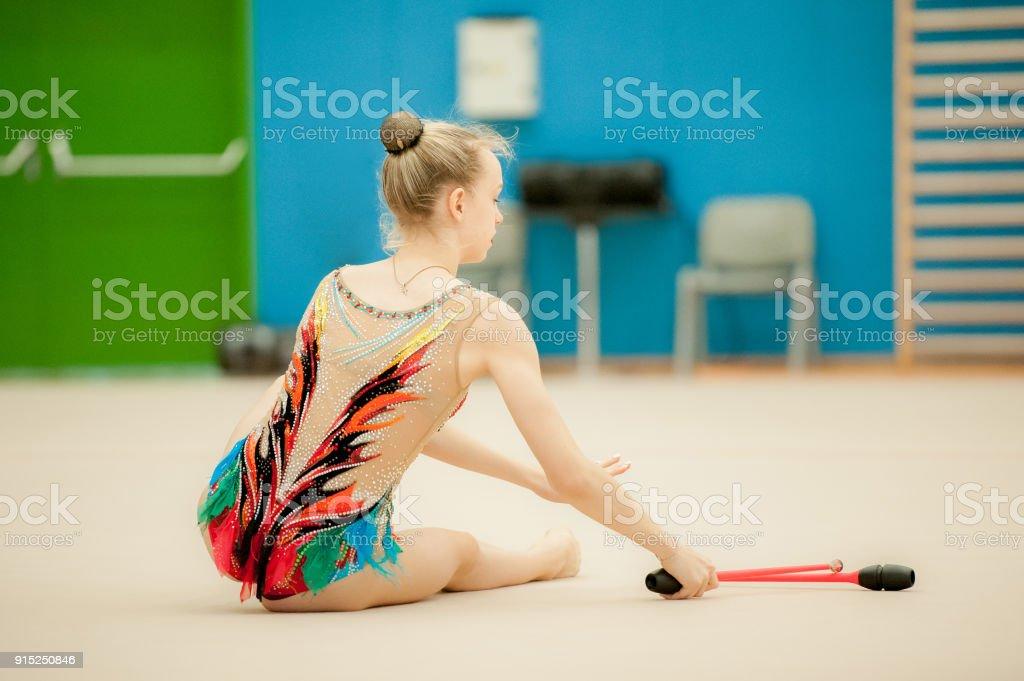 Young Rhythmic Gymnastics Athlete Getting Up.