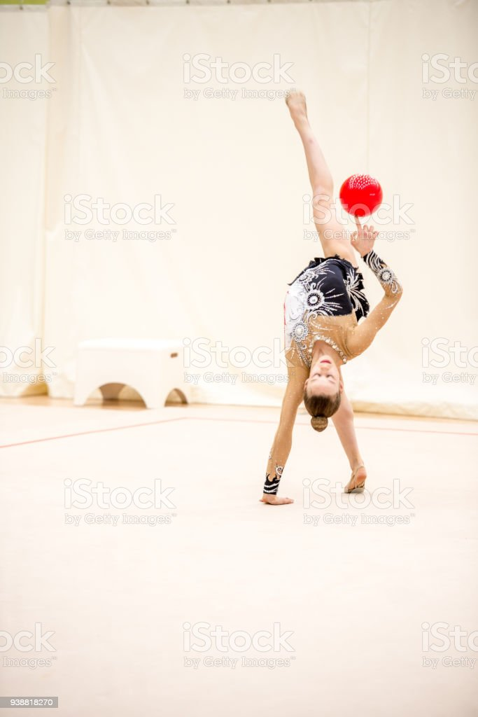 Young Rhythmic Gymnastics Athlete Practicing with Ball.