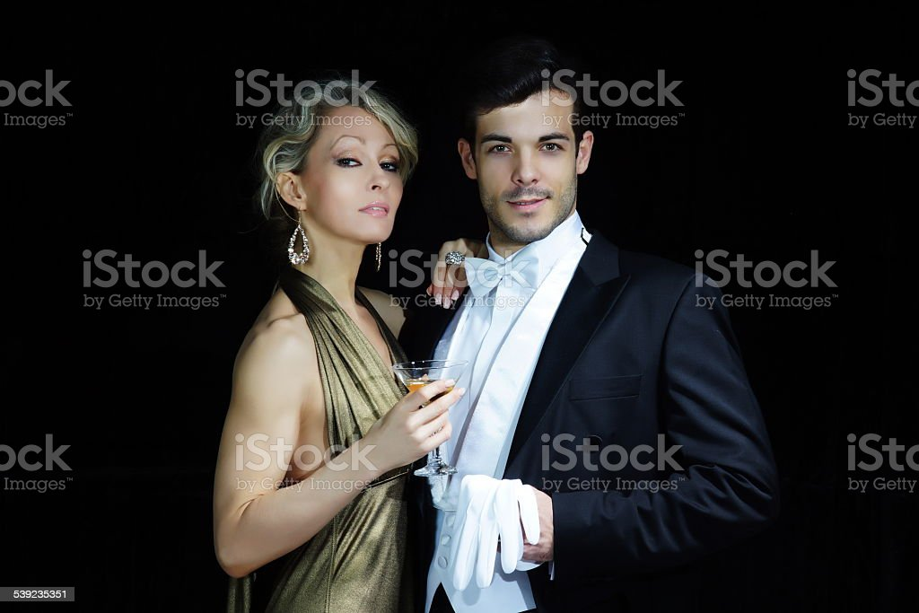 Young rich couple at luxury party stock photo
