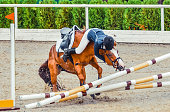 Horse show jumping accident. Equestrian sport background.