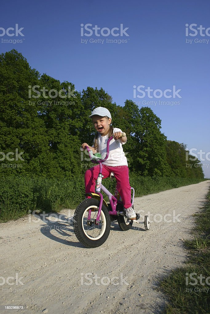 Young Rider - kid on a bicycle royalty-free stock photo