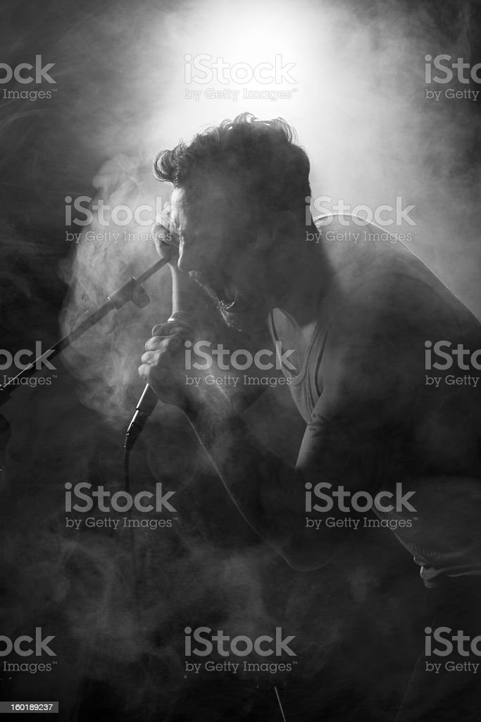 Young Rocker in Hard Rock Concert stock photo