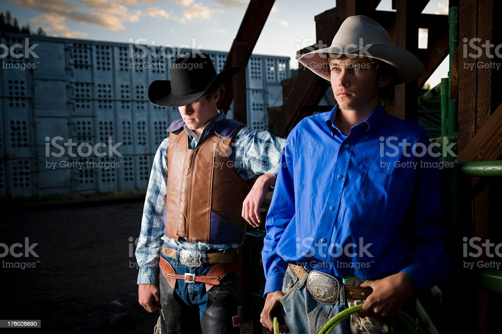 Young Rodeo Cowboys at sunset in Colorado stock photo