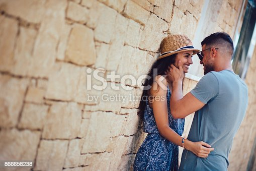 istock Young romantic couple flirting and looking in each other's eyes 866658238