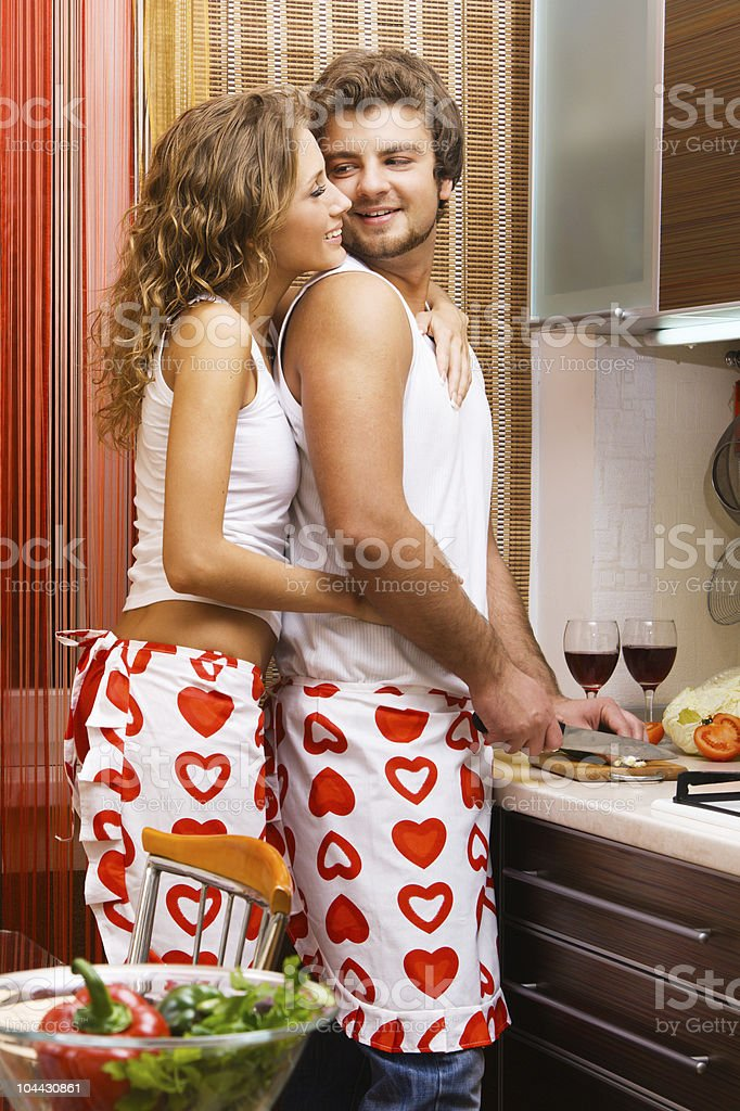 Young romantic couple in the kitchen royalty-free stock photo
