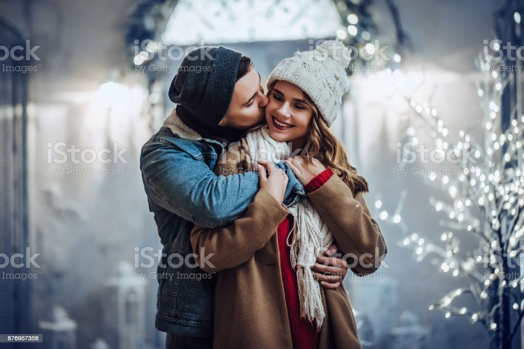 Young romantic couple is having fun outdoors in winter stock photo