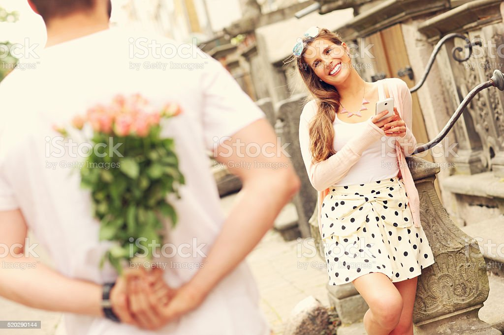 Young romantic couple on a date in the city stock photo