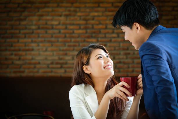 Young romantic couple Smiling happy in a cafe