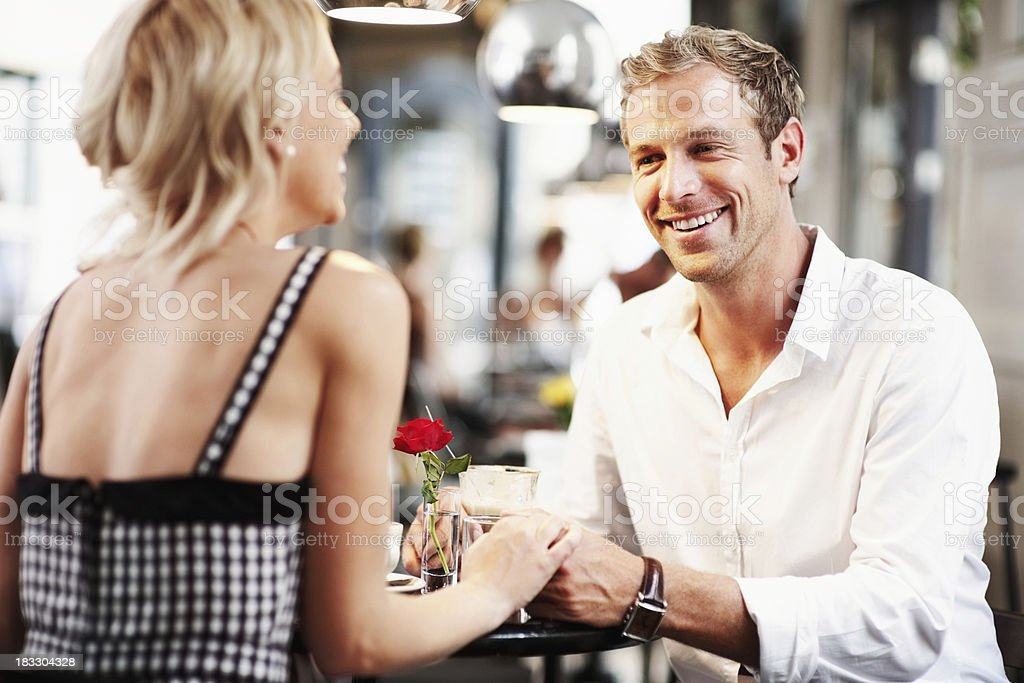 Young romantic couple spending time at cafe royalty-free stock photo