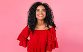 istock Young rose. Magnificent African American lady in a red blouse is laughing while standing right in front of the camera. 1182101198