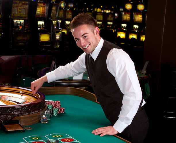 6 005 Casino Dealer Stock Photos Pictures Royalty Free Images Istock